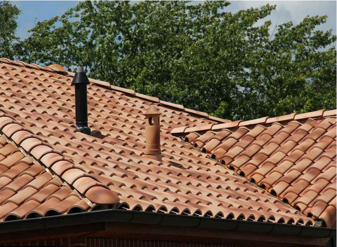 Clay roof tiles synergy building systems building for Clay tile roofs